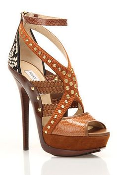 Although I highly doubt that they would where heels this high during Lysistrata's time, the design reminds me of gladiators. So without the heel I would love them for a woman's shoe.