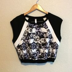 Floral Crop Top This cool crop top is a mix of black, white, and floral. Xhilaration Tops Crop Tops
