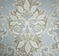 Rococo Wallpaper A wide width damask wallpaper inspired by Indian block prints and rococo motifs designed by Melissa White. Printed in gold and cream on a pale blue mottled background.