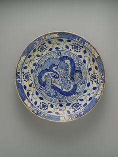 Dish with Two Intertwined Dragons, Kirman, Iran, ca 1640, stonepaste, painted in blue under transparent glaze