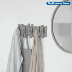 The beauty of the polished Sticks Multi-Hook Rack by Umbra is what you don't see. When not in use, the five hooks fold flat so all that's visible is a sleek, sculptural design. You can flip each hook down as needed to hang coats, jackets, scarves and hats. It's perfect for narrow spaces. Made from durable molded ABS plastic; mounting hardware included.