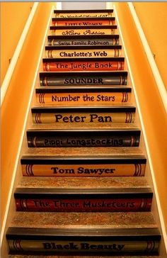 19) Stairs: book stairs saying: Marie Antoinette, Hunger games, Catching fire, mockingjay, Harry Potter, Divergant, Spooks, I am number 4 etc... x
