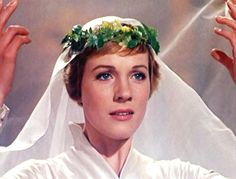 Maybe I could do something like this to incorporate both a veil and a floral wreath (Julie Andrews from Sound of Music)