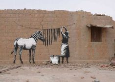 Banksy – O Grafiteiro Anônimo, Polêmico e Criativo