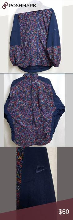 """VTG Nike Floral Blue Windbreaker LARGE Women's This is a VTG Nike Floral Blue Windbreaker LARGE Women's. There are no stains, snags, or holes.  Measurements: (When laid flat)  Armpit to armpit: 26""""  Around chest: 52"""" Top of shoulder to bottom: 28""""  Product material:  Nylon  Polyester   Inventory #: Nike Jackets & Coats"""