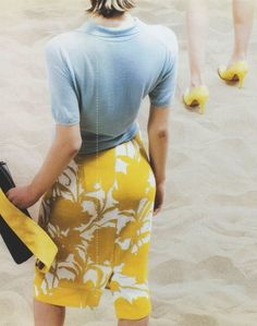 Gorgeous Yellow print pencil skirt + blue sweater with clutch.