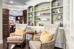 Pops of color on the #cushions and the #shelves bring out the #pattern of the #chairs.  #EricRossInteriors #Basement