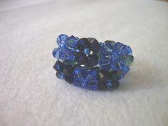 Anillo de tupis swaroski en tonos azules.  caprichosmarja@gmail.com
