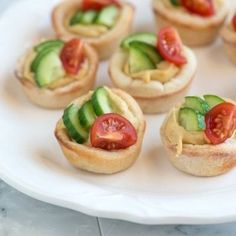 Easy Appetizer – Hummus Cups With Cucumber and Tomato...these are fantastic. I used the pastry cups from the freezer section and the sabra hummus...so good and even quicker