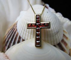 Simple and stunning describe this 18k Cross Spessartite Garnets invisible set, 20 inch box chain in perfect condition. EverythingIOwn