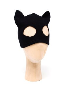 London-based street couture label, Silver Spoon Attire, fashion cool and quirky head pieces that have quickly become firm celebrity favourites. Crafted in Scotland from pure cashmere, this black cat mask is a unique take on the brand's iconic beanie hat. It features playful cat ears and two circular cut-outs so the piece can sit comfortable over the eyes.