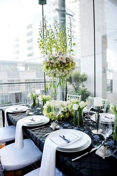 Modern black and green spring tablescape--seems that draped napkins are the latest!