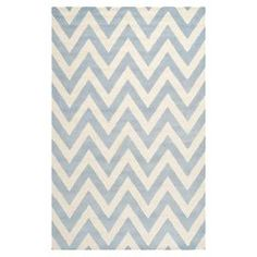 """Anchor your living room seating group or define space in the den with this artfully hand-tufted wool rug, featuring a chevron motif for eye-catching appeal.  Product: RugConstruction Material: WoolColor: Light blue and ivoryFeatures:   Chevron motifHand-tuftedMade in IndiaPile Height: 0.63"""" Note: Please be aware that actual colors may vary from those shown on your screen. Accent rugs may also not show the entire pattern that the corresponding area rugs have.Cleaning and Care: Professional…"""