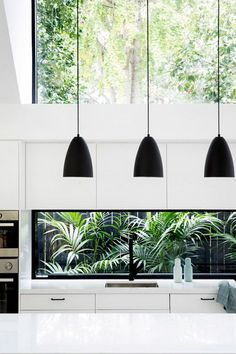 white kitchen, bold black accents