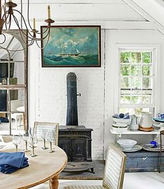 The dining room feels cozy and charming. Love that painting too!