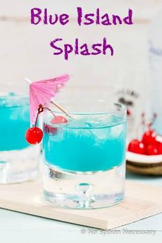 Blue Island Splash- A Tropical Cocktail shaken with Malibu Rum, Blue Curacoa, Pineapple Juice & Sprite.
