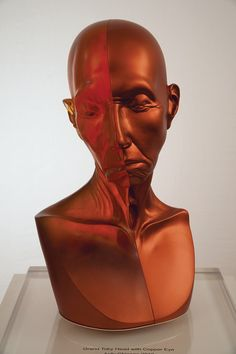 """Description of . """"Grand Toby Head with Copper Eye"""" by Judy Chicago is typical of the works on sale at Habatat Gallery in Royal Oak's 43rd International Glass Exhibition.  Courtesy Habatat Gallery http://www.habatat.com/artist/167-judy-chicago"""