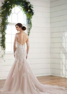 Romantic wedding dress idea - long sleeve wedding dress with ope back and blush underlay. Style D2425 from Essense of Australia. See more wedding dress inspo on WeddingWire!