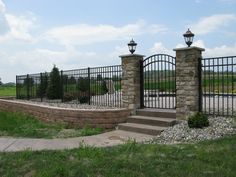 There is something so classic, regal, and stately about the combination of stone and aluminum fencing.