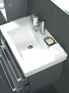 Additional storage where you need it, attractive integrated wash basin, masculine modern design, floating wall mounted vanity.