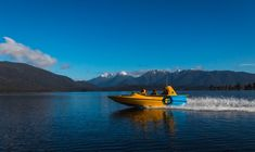 Get ready for a thrilling jet boat ride across Lake Te Anau. Head towards Dock Bay and get an up-close peek into Fiordland National Park! Te Anau, Jet Boat, Hit The Floors, Boat Tours, South Island, Great Lakes, Backpacking, National Parks, Southern