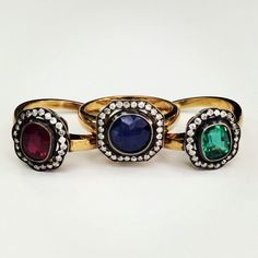 Any of these would make an amazing engagement ring! I love the black gold around the pave stones! #ruby #sapphire #emerald