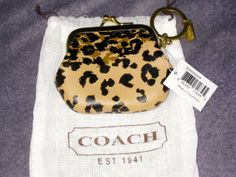 'BNWT Coach Madison Ocelot print leather pouch ' is going up for auction at  2pm Fri, Jan 10 with a starting bid of $1.