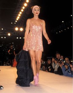 Cindy Crawford wears a pink sequin mini dress for Isaac Mizrahi in 1994