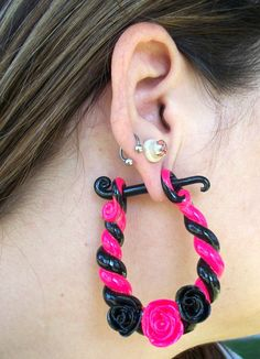 Roses and Rope ear clay ear gauges, via Etsy.