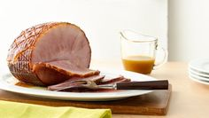 Cooking your ham in the slow cooker keeps it moist and flavorful without fear of drying out. The maple brown sugar mixture makes a fantastic sauce to serve with the ham.