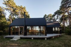 Love this gorgeous modern cabin with black, timber and lots of windows! Modern Architecture House, Interior Architecture, Pavilion Architecture, Sustainable Architecture, Residential Architecture, Cabin Design, House Design, Shed Homes, House In The Woods