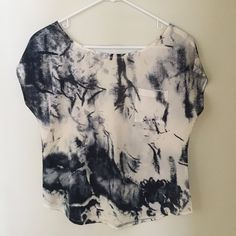 Boxy top with strap across back One strap that runs horizontally across the back. Pocket on front. Cream colored with grey pattern. Never worn, in perfect condition. Kirra Tops Tees - Short Sleeve