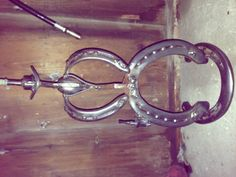 Horseshoe cowboy. This could be made into a lamp.
