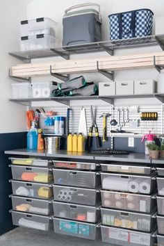 The garage at DIY Network Ultimate Retreat 2017 offers a well-organized storage system for tools, garden supplies and lake essentials, with space for hobbies and projects. #GlassShelvesSystem