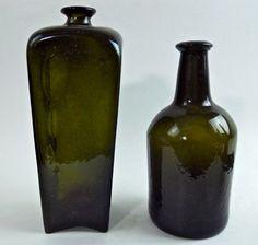 Two 18th C. Black Glass Spirit Bottles : Lot 74  www.JJamesAuctions.com