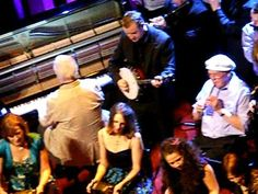 In addition to being a great actor, Brendan Gleeson is a respected traditional fiddler.  Here he is playing (at the 1:17 minute) in the finale of the Traditional Music Awards , An Gradam Ceoil, in 2009.  That is John Carty on banjo in the screen shot.