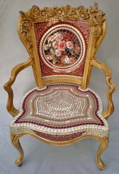 Mosiac chair. I like the base part of the mosaic more than the backrest.