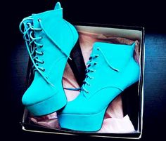 Outrageous blue leather platform booties.