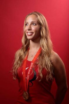 Mariel Zagunis is the daughter of two Olympic rowers and won golds in fencing in 2004 and 2008.