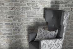 Stylisch, modern, passt in fast jedes Wohnzimmer und gehört zum Winter wie der Schnee - ein kuscheliger Ohrensessel. Foto: FINE