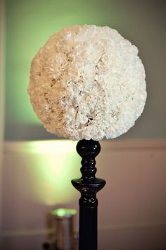 An idea for a Carnation flower pomander centerpieces (done in yellow for your wedding colours).