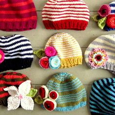 baby hats:)- love the colourful flowers and the stripes together.
