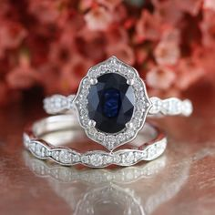 This vintage inspired bridal set showcases a floral sapphire engagement ring with oval cut medium dark royal blue natural sapphire set in a solid white gold scalloped diamond band. To complete the stunning look, a scalloped diamond wedding band Diamond Bands, Diamond Wedding Bands, Diamond Jewelry, Wedding Rings, Bridal Rings, Diamond Necklaces, Saphire Ring, Blue Sapphire Rings, Sapphire Ring Engagement