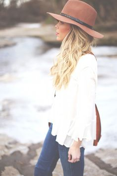white flowy blouse + hat.