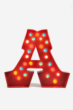 Lights (...camera, action)! Reminiscent of theatres past, this oversized letter marquee fixture adds light and vintage-inspired charm to any room. Hang it on your wall, set it on a shelf - the possibilities are endless ... and bright. Weathered red enamel finish. $189.00