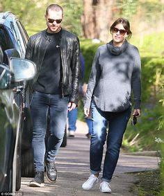 Counting down: Heavily pregnant Emma Willis and husband Matt enjoy an afternoon stroll in ...