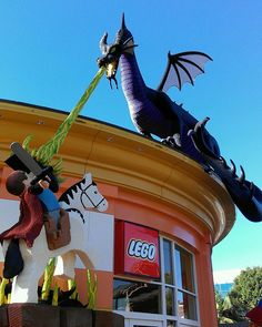 Giant Lego Maleficent dragon, Prince Phillip and Samson.