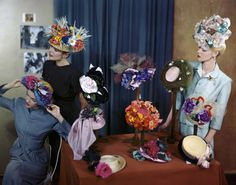 "Models wearing hats by John Frederics, Tatiana du Plessix, Lilly Daché, Suzanne Remy, Henry Bendel, and Bergdorf Goodman, in setting based on Degas' painting ""At the Milliners"" shot for Vogue, 1945 by Erwin Blumenfeld."