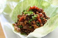 This PF Changs lettuce wraps recipe is so tender and juicy, it tastes better than the restaurant's. A quick and easy Asian chicken lettuce wrap. Pf Changs Lettuce Wraps, Vegetarian Lettuce Wraps, Asian Chicken Lettuce Wraps, Lettuce Wrap Recipes, Poulet Tikka Masala, Snacks Sains, Asian Recipes, Ethnic Recipes, Chicken