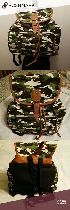 Camo backpacks Brand new light weight camo backpacks with drawstring closure, snap & buckle flap, adjustable shoulder straps, front pocket and one zippered pocket on the inside great for light travel. none  Bags Backpacks